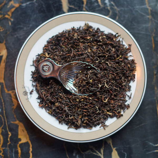 Plate of Loose Tea with Silver-Plated Caddy Spoon