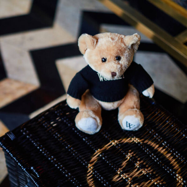 The Wolseley's teddy bear on top of a hamper - Gift Shop