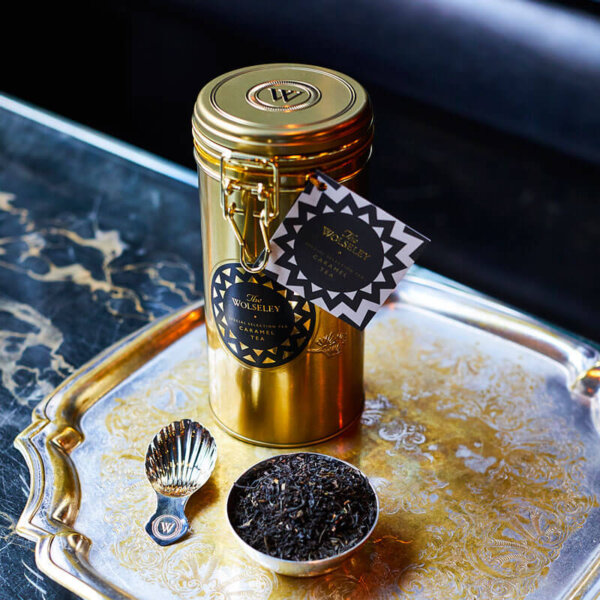 Gold plated caramel tea tin and silver plated caddy spoon and loose leaf tea - The Wolseley