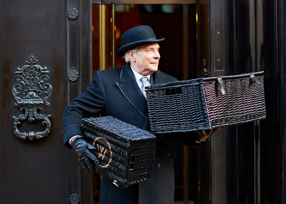 Staff at the Wolseley entrance with two hampers