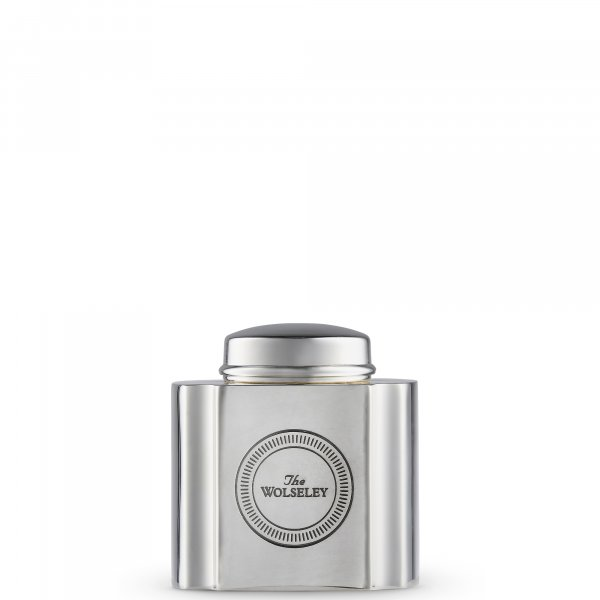 silver tea caddy and The Wolseley's red box