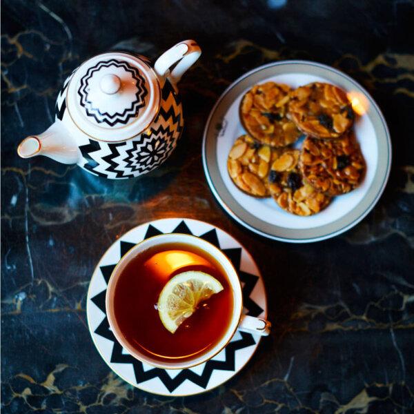 dark chocolate florentines, cup of tea and fine bone china tea for one